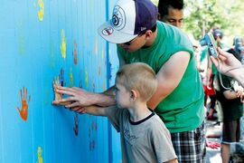 Neighbourhood children put their handprints on a freshly painted building at Machray Park in July 2013. A new name for the park is being considered.