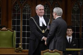 The House of Commons is back in action, kicked off by an exhilarating show of support for Sergeant-at-Arms Kevin Vickers who was among those who opened fire Wednesday on the gunman. Prime Minister Stephen Harper shakes Vickers's hand in the House of Commons this morning in Ottawa.