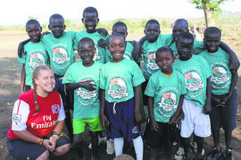 Amanda Furst, Epic Dodgeball Unleashed organizer and Growing Opportunities International founder, alongside a group of East African children.
