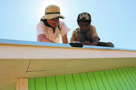 July 2014 - Winnipeg's Sean Vincent and a local youth finish putting the flashing on a home built by a group of Scouts and Guides from Winnipeg as part of Live Different's Build a Home Challenge Mexico 2014. (SUPPLIED)