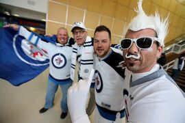 Winnipeg Jets' fans, from left, Yves Lapointe, Guy Chateau, Russ Lapointe, and Marc Chateau cheering for their team prior to game three NHL playoff hockey against the Anaheim Ducks action in Winnipeg, Monday, April 20, 2015. THE CANADIAN PRESS/Trevor Hagan