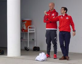 Toronto FC captain Michael Bradley (left) and general manager Tim Bezbatchenko chat after Toronto's 2-1 win over the Costa Rican under-23 team in pre-season action in Bradenton, Florida on Saturday Feb. 28, 2015. THE CANADIAN PRESS/Neil Davidson