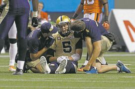 Winnipeg Blue Bombers' Drew Willy (5) is checked by medical staff after getting injured while playing against the BC Lions during the second half of their CFL football game in Vancouver Saturday.