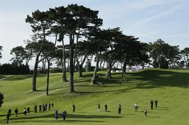 Lydia Ko, of New Zealand, hits from the fairway up to the 17th green during the final round of the Swinging Skirts LPGA Classic golf tournament Sunday, April 26, 2015, in Daly City, Calif. Ko won the tournament on the second playoff hole defeating Morgan Pressel. (AP Photo/Eric Risberg)
