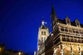 Ypres, Belgium is a rebuilt medieval city that was devastated during the First World War. Cloth Hall, the building to the right, was erected in the 14th century and rebuilt in the 20th.