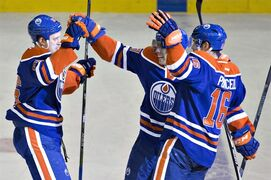 Edmonton Oilers' Nikita Nikitin (86), David Perron (57) and Teddy Purcell (16) celebrate a goal against the Washington Capitals during second period NHL hockey action in Edmonton, Alta., on Wednesday October 22, 2014. THE CANADIAN PRESS/Jason Franson