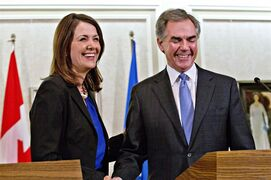 Alberta Premier Jim Prentice and former Wildrose Leader Danielle Smith speak to media after a caucus meeting in Edmonton Alta., Wednesday, December 17, 2014. Prentice's caucus met to discuss a bid by at least half the official Opposition to cross the floor. THE CANADIAN PRESS/Jason Franson