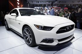 FILE - In this April 16, 2014 file photo, the 2015 Ford Mustang 50 Year Limited Edition is introduced at the 2014 New York International Auto Show at the Javits Convention Center, in New York. Ford on Tuesday, Jan. 20, 2015 said its first shipload of around 100 Mustangs has left Portland, Ore., and is headed to China. Shipments to Europe will begin later this year. It's the first time in the Mustang's 50-year history that it will be sold overseas. (AP Photo/Richard Drew, File)