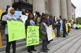 About 60 Sierra Leoneans and supporters held a rally at the Legislative Building Wednesday to raise awareness about the Ebola epidemic hitting their country and others in West Africa.