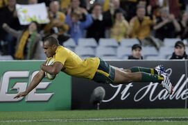 FILE - IN this Aug. 17, 2013 file photo, Australia's Will Genia makes a break to score a try during the Bledisloe Cup rugby union match against New Zealand, in Sydney, Australia. Scrumhalf and former captain Will Genia has been recalled to an Australian squad for the last two rounds of the Rugby Championship that will be without giant young lock Will Skelton. (AP Photo/Rob Griffith, File)