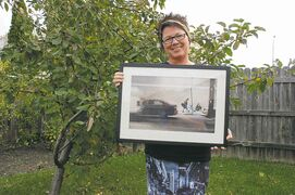 "Transcona resident Carla Dyck holds up a photo she took in Chicago that inspires her to ""(trudge) through the ordinary""."