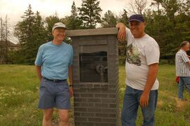 Dirk and Rob de Graaf are shown at a pillar marking the family's community contributions at de Graaf Nature Park.
