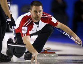 Newfoundland and Labrador skip Brad Gushue throws the winning rock as he defeats Team Canada during curling action at the Brier in Calgary, Sunday, March 1, 2015.THE CANADIAN PRESS/Jeff McIntosh