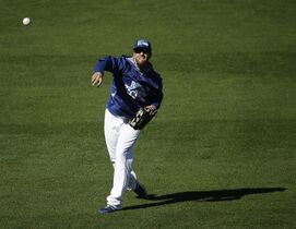 Kansas City Royals starting pitcher James Shields throws during baseball practice Monday, Oct. 20, 2014, in Kansas City, Mo. The Royals will host the San Francisco Giants in Game 1 of the World Series on Oct. 21. (AP Photo/Charlie Riedel)
