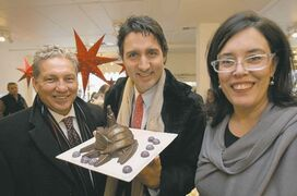JOE BRYKSA / WINNIPEG FREE PRESS St. Boniface Liberal candidate Dan Vandal (left) and party Leader Justin Trudeau stop Friday at a Provencher Boulevard chocolate business owned by Constance Menzies.