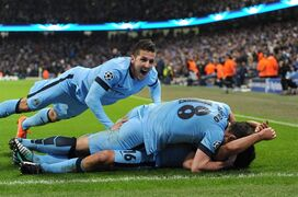 Manchester City's Sergio Aguero, bottom, celebrates scoring his sides third goal of the game alongside teammates Frank Lampard and Stevan Jovetic, left, during the UEFA Champions League match at the Etihad Stadium, Manchester, England, Tuesday Nov. 25, 2014. (AP Photo/PA, Tim Goode) UNITED KINGDOM OUT NO SALES NO ARCHIVE