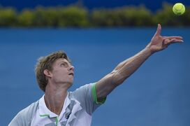 Kevin Anderson of South Africa serves to Kei Nishikori of Japan during a Mexican Tennis Open semifinal match in Acapulco, Mexico, Friday, Feb. 27, 2015. (AP Photo/Christian Palma)