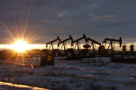 FILE - In this Jan. 14, 2015 file photo, some of the 60 rigs that are drilling surrounding McKenzie County, 40 percent of the rigs statewide, work in western North Dakota. Released on Tuesday, April 21, 2015, unemployment rates fell in 23 U.S. states last month and rose in 12 as employers pulled back on hiring and a slowdown in oil and gas drilling caused big job losses in some states. (AP Photo/Matthew Brown, File)