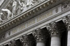 FILE - This Oct. 2, 2014 file photo shows the facade of the New York Stock Exchange, in New York. U.S. stocks are opening slightly higher Monday, March 2, 2015, as investors focused on earnings and deal news. (AP Photo/Richard Drew, File)