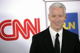 FILE - In this Jan. 10, 2014 file photo, Anderson Cooper of CNN poses at the CNN Worldwide All-Star Party in Pasadena, Calif. CNN has joined Fox News Channel in saying that it was mistaken to report in the wake of an attack on the French newspaper Charlie Hebdo that there were neighborhoods in Europe considered