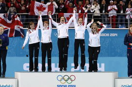 Kirsten Wall (from left), Dawn McEwen, Jill Officer, Kaitlyn Lawes and skip Jennifer Jones, celebrate during the flower ceremony after winning the women's curling gold medal in Sochi.