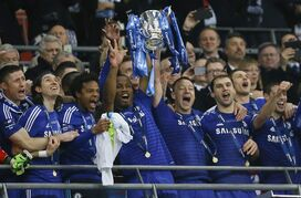 Chelsea's John Terry, centre right and teammate Chelsea's Didier Drogba hold up the English League Cup after its presentation to the team following the soccer match between Chelsea and Tottenham at Wembley stadium in London, Sunday, March 1, 2015. Chelsea won 2-0.(AP Photo/Kirsty Wigglesworth)