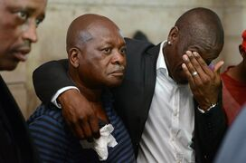 Orlando Pirates team mate Lucky Lekgwathi, right, with father of slain Senzo Meyiwa, Sam Meyiwa, second from left, at the family home of Senzo Meyiwa in Umlazi, near Durban, South Africa, Tuesday, Oct. 28, 2014. Meyiwa, the national soccer captain, was shot and killed at the home of his girlfriend in Vosloorus, east of Johannesburg, Sunday night during a robbery attempt. He will be laid to rest Saturday at a funeral in Umlazi. (AP Photo)