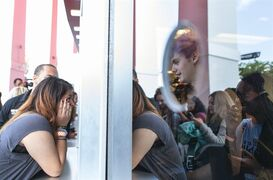 A fan reacts to seeing band member Michael Clifford inside the box-office as she purchases tickets during a pre-sale event for their Nov. 15, 2014 show at the Forum in Inglewood, Calif. on Saturday, July 26, 2014. (Photo by Paul A. Hebert/Invision/AP)