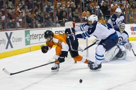 Philadelphia Flyers' Claude Giroux, (28) gets pushed out of the way by Winnipeg Jets' Mark Stuart as he tried to shoot the puck at Ondrej Pavelec, of Czech Republic, right, during the second period of an NHL hockey game Friday in Philadelphia.