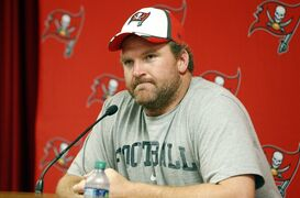 FILE - In this Aug. 28, 2014, file photo, new Tampa Bay Buccaneers guard Logan Mankins meets with members of the media before an NFL preseason football game against the Washington Redskins in Tampa, Fla. Mankins says he isn't upset by a trade that sent him from New England to Tampa Bay. He's focused on learning the playbook and helping the Buccaneers' struggling offensive line. (AP Photo/Brian Blanco, File)