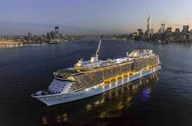 This Nov. 10, 2014 photo shows Royal Caribbean cruise line's new Quantum of the Seas ship sailing into New York Harbor after completing its first trip across the Atlantic. The ship is the first at sea to offer attractions like bumper cars, simulated skydiving and an observation capsule called The North Star, with a bird's eye view 300 feet (91 meters) above the water. (AP Photo/Royal Caribbean)