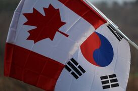 A Canadian flag and a South Korean flag fly in Yongin, South Korea on Tuesday, March 10, 2014. THE CANADIAN PRESS/Sean Kilpatrick