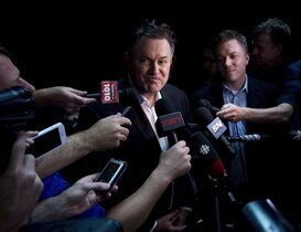 Tim Leiweke, President and CEO of Maple Leaf Sports Entertainment (MLSE) speaks to the media after participating in the ALS Ice Bucket Challenge in Toronto on Wednesday, August 20, 2014. THE CANADIAN PRESS/Nathan Denette