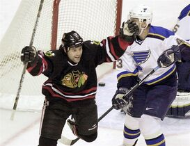 Chicago Blackhawks' Mike Peluso, left, celebrates after scoring against the St. Louis Blues during the first period in St. Louis Wednesday, Dec. 26, 2001. The consolidated class-action lawsuit by former NHL players, including Peluso, against the league over concussion-related injuries has been filed in federal court. THE CANADIAN PRESS/ AP/James A. Finley
