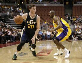 Utah Jazz's Gordon Hayward, left, drives against Los Angeles Lakers' Kobe Bryant during the first half of a preseason NBA basketball game Thursday, Oct. 16, 2014, in Anaheim, Calif. The Jazz won 119-86. (AP Photo/Jae C. Hong)