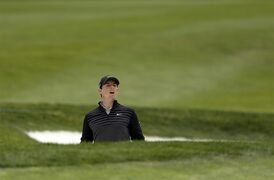 Rory McIlroy, of Northern Ireland, looks out of a bunker to follow his shot on the fifth hole of the Match Play Championship golf tournament at TCP Harding Park on Sunday, May 3, 2015, in San Francisco. McIlroy won the tournament. (AP Photo/Ben Margot)