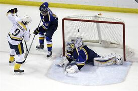 Nashville Predators' Filip Forsberg, left, of Sweden, scores past St. Louis Blues goalie Brian Elliott, right, and Jori Lehtera, of Finland, during the second period of an NHL hockey game Thursday, Jan. 29, 2015, in St. Louis. (AP Photo/Jeff Roberson)