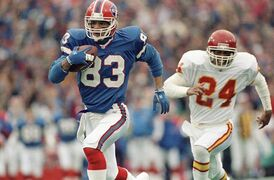 FILE - In this Jan. 15, 1992, file photo, Buffalo Bills wide receiver Andre Reed runs with the ball during an AFC playoff football game against the Kansas City Chiefs in Orchard Park, N.Y. Reed awaits induction to the Pro Football Hall of Fame this weekend, and says the eight-year wait didn't feel that long. (AP Photo/Mark Duncan, File)