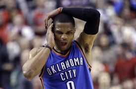 Oklahoma City Thunder guard Russell Westbrook walks down court with only seconds to go during the second half of an NBA basketball game against the Portland Trail Blazers in Portland, Ore., Friday, Feb. 27, 2015. Westbrook scored 40 points but missed an opportunity to tie the game, making only two of three free throws with just seconds left. Portland won 115-112. (AP Photo/Don Ryan)