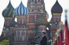 Russian President Vladimir Putin speaks during a Victory Day Parade, which commemorates the 1945 defeat of Nazi Germany, in Red Square, with St. Basil Cathedral in the background, in Moscow, Russia, Friday, May 9, 2014. Putin made no reference to the situation in Ukraine when he opened Friday's parade, focusing on the historic importance of the victory over Nazi Germany.
