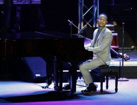 John Legend performs in Muharraq, Bahrain, Monday night, March 2, 2015. The singer-songwriter performed before an enthusiastic, sold-out crowd despite human rights activists' calls to boycott the Gulf island monarchy, where a pro-democracy uprising still simmers four years after authorities crushed Bahrain's Arab spring. (AP Photo/Hasan Jamali)
