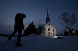 A journalist takes a photo of the church in La Motte, Que., at twilight Wednesday March 13, 2013. Earlier this year, when Quebec Cardinal Marc Ouellet was considered a contender to become pope, the world's attention was briefly trained on his tiny Abitibi hometown of La Motte, where the church has been turned into a community centre and only occasionally hosts mass. THE CANADIAN PRESS/Adrian Wyld