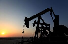 A row of oil pumps work at sunset Sept. 11, 2013, in the desert oil fields of Sakhir, Bahrain. THE CANADIAN PRESS/AP, Hasan Jamali