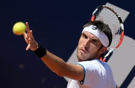 Leonardo Mayer of Argentina serves to Germany's Philipp Kohlschreiber in their semi final match at the German Open tennis tournament in Hamburg, Germany, Saturday, July 19, 2014. Mayer won the match with 7-5 and 6-4. (AP Photo/dpa, Daniel Reinhardt)