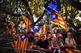 """People wave """"estelada"""" flags, that symbolize Catalonia's independence, during a demonstration calling for the independence of Catalonia in Barcelona, Spain, Friday, Sept. 19, 2014. A day after Scotland rejected breaking away from Britain, the regional parliament in Spain's Catalonia is expected to grant its leader the power to call a secession referendum that the central government in Madrid says would be illegal. Spanish Prime Minister Mariano Rajoy has vowed to prevent the Nov. 9 vote that separatist Catalans want to hold in the wealthy Mediterranean region of 7.5 million people. Spain's constitution doesn't allow referendums that do not include all Spaniards and experts say Spain's Constitutional Court would rule the vote illegal. The referendum in Catalonia wouldn't result in secession; it would ask Catalans whether they favor secession. If the answer is Yes, Catalan regional leader Artur Mas says that would give him a political mandate to negotiate a path toward independence. (AP Photo/Manu Fernandez)"""