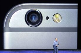 FILE - In this Sept. 9, 2014 file photo, Phil Schiller, Apple's senior vice president of worldwide product marketing, discusses the camera features on the new iPhone 6 and iPhone 6 plus during an event in Cupertino, Calif. The Associated Press reviews three phones that stand out for taking photos. (AP Photo/Marcio Jose Sanchez, File)