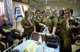 Israeli soldiers and family members visit an Israeli soldier wounded during fighting in Gaza at Soroka hospital In Beer Sheva, southern Israel, Tuesday, July 29, 2014. (AP Photo/Oded Balilty)