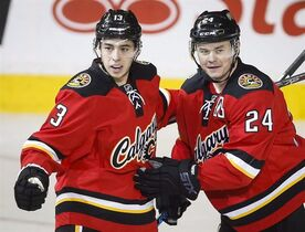 Calgary Flames Jiri Hudler, right, elebrates his goal with teammate Johnny Gaudreau during second period NHL hockey action against the Toronto Maple Leafs in Calgary, Friday, March 13, 2015. Gaudreau was named NHL Rookie of the Month for March on Wednesday.THE CANADIAN PRESS/Jeff McIntosh