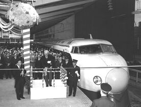 In this Oct. 1, 1964 photo, a ceremony is held to mark the launch of Japan's Shinkansen, a high speed train, between Tokyo and Osaka, at Tokyo Station in Tokyo. Zipping cross-country in a super-high speed train has become commonplace in many countries these days, but it was unheard of when Japan launched its bullet train between Tokyo and Osaka 50 years ago Wednesday, Oct. 1, 2014. (AP Photo/Kyodo News) JAPAN OUT, MANDATORY CREDIT