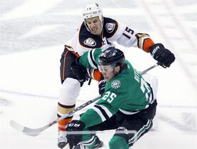 Dallas Stars right wing Brett Ritchie (25) is shoved by Anaheim Ducks center Ryan Getzlaf (15) in the first period of an NHL hockey game, Sunday, March 1, 2015, in Dallas. (AP Photo/Tim Sharp)
